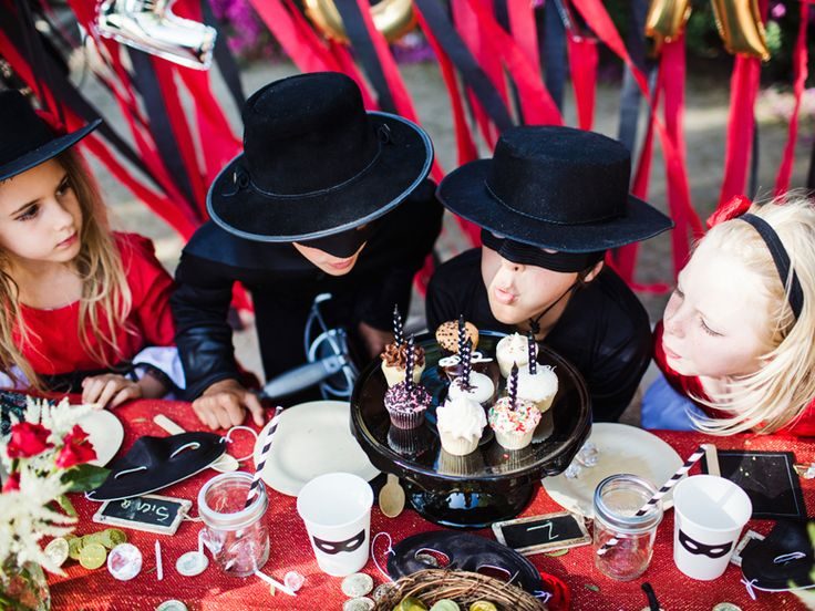 Fire and Creme's Zorro-themed boxes include chocolate coins, a red and gold tablecloth, vintage fans, and mask-adorned paper cups. Want to take it truly over the top? North also hired two black ponies and a pair of sword fighters when she threw this party for her boys.