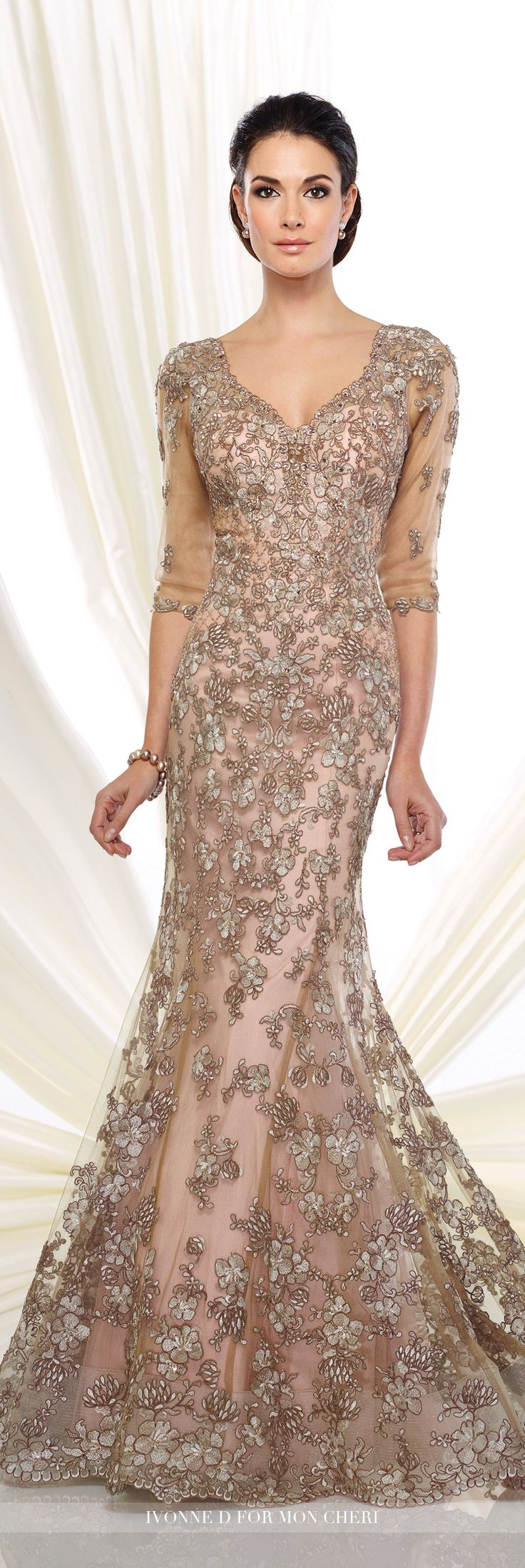 Ivonne D Exclusively for Mon Cheri - 216D52 - Tulle trumpet dresswith hand-beaded and illusion lace three-quarter length sleeves, front and back curved V-necklines, sweetheart bodice, horsehair hemline, sweep train.  Sizes: 4 - 20, 16W - 26W  Taupe/Pink, Oyster