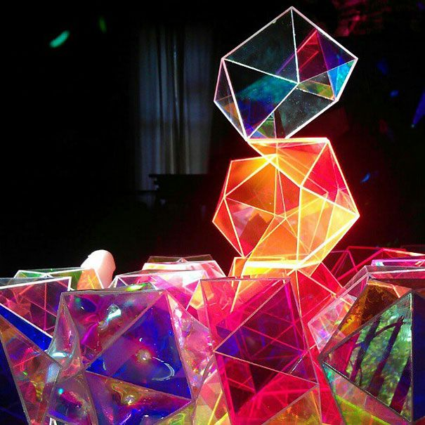 A round glass tabletop is placed on a reversed pyramid of elegantly cut glass crystals, which divide the natural light into hundreds of rainbow reflections ...