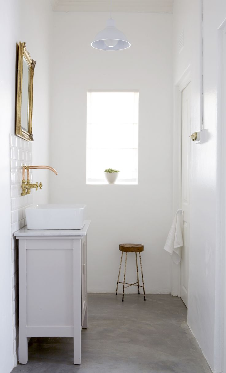 Vintage cabinet painted and used as basin pedestal. Interiors by Jean-Pierre de la Chaumette.