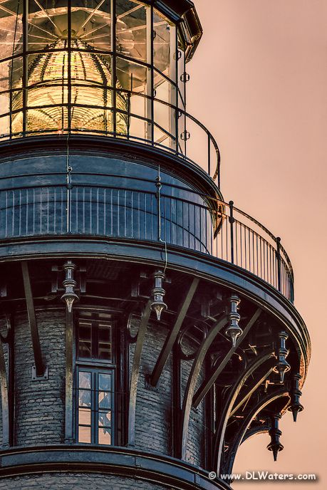 A close-up stylized photo of Bodie Island Lighthouse's Fresnel lens on the Outer…