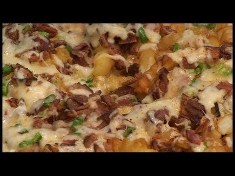 Bacon Cheese Fries recipe by the BBQ Pit Boys - Nothing like charcoal or wood smoked Bacon Cheese Fries to serve up as a side dish for steaks, burgers or sausages. But, as you may know, not all cheese fries are the same. So be sure to check out the BBQ Pit Boys as they show you how quick and easy it is to grill up a batch, BBQ Pit Boys style, at your Pit..!