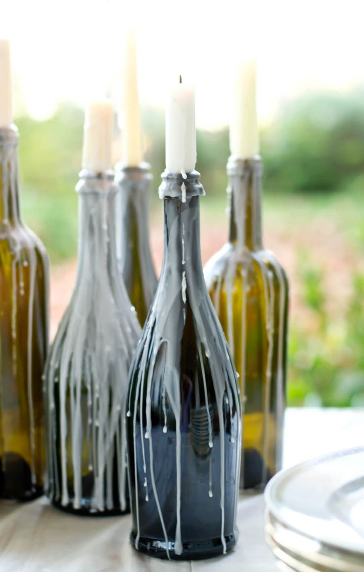 Dripping candles in wine bottles. Photography by Lauren Michal / laurenmichal.com, Event Design   Rentals by Moira Events / moiraevents.com