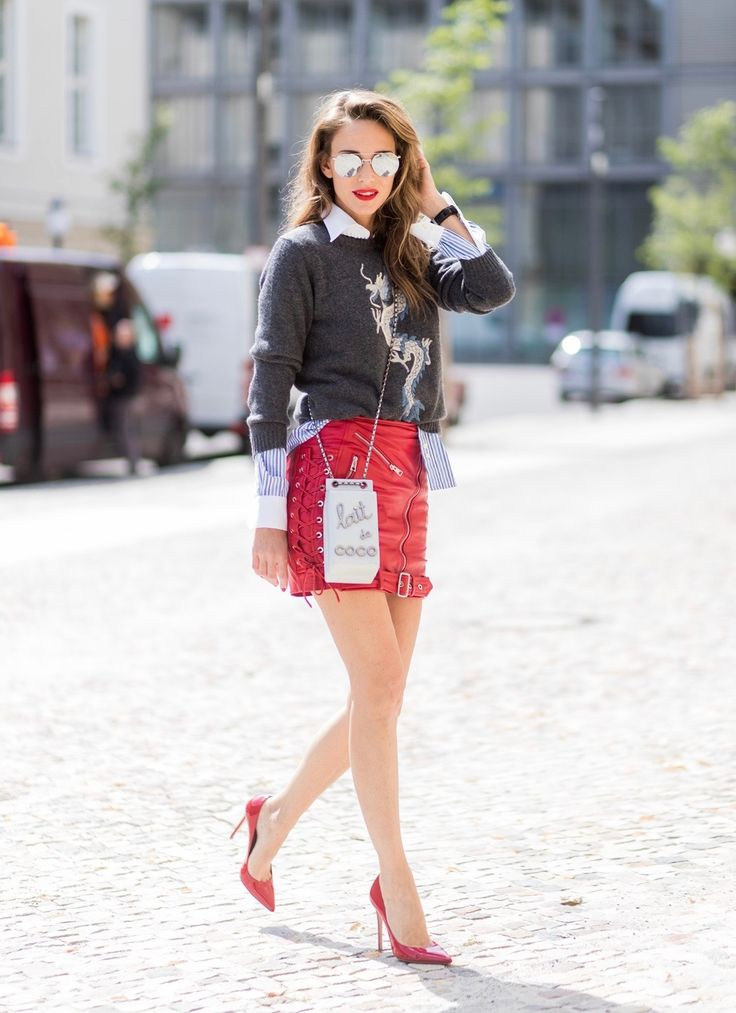 Alexandra Lapp (model, blogger) wearing a cashmere pullover with a Chinese Dragon from Heartbreaker in cashmere, a grey cashmere scarf by Heartbreaker, a blue-white striped shirt from Etro, rocking Biker skirt with zippers in silver, a red lambskin leather skirt, zip front closure, front zip pockets and lace up detail on sides, red patent leather pumps from Gianvito Rossi, the Chanel Milk Bottle Bag Lait de Coco from 2014, a chain shoulder bag with pearls in silver-grey, in the shape of a…