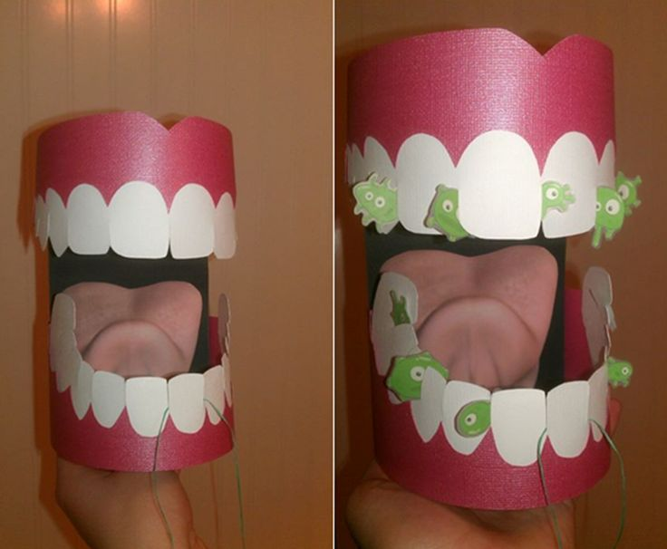 Easy DIY flossing activity for kids made from stock paper. 'Sugar bugs' removed with actual floss.