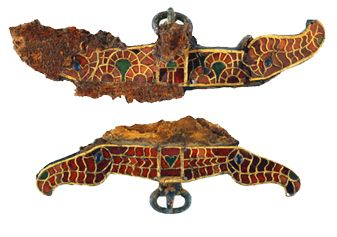 These purse clasps were found alongside the backs of the deceased. They have a cloisonné decoration of garnets and glass figuring horse head. The grave goods of the aristocratic Frankish burials at Saint-Dizier.