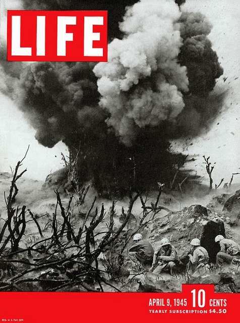 The cover of Life magazine features a photo of US Marines, in battle of iwo jima.