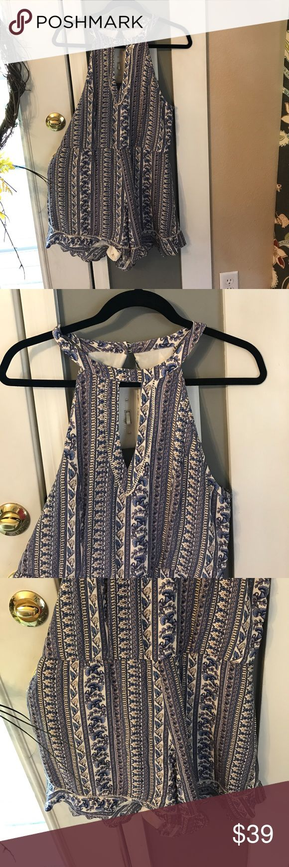 American Eagle Romper, blue floral print Excellent like new condition, wore a few hours only. Pic of materials in photos. Romper , from neck to bottom measures approximately 29 inches give or take. Color blue and white, very cute. Women's romper, key hole on front neckline and two button closure on back neck line.  Price firm American Eagle Outfitters Shorts