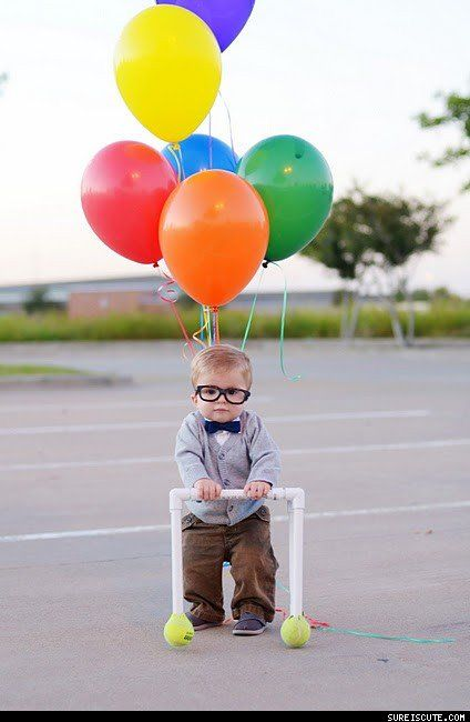 a baby dressed as the old man from 'up' - Halloween costume