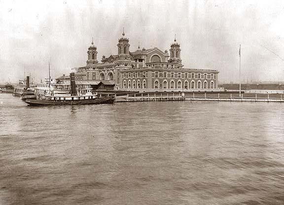 View of Ellis Island, N.Y., looking across water toward immigration station.  It was built in 1913