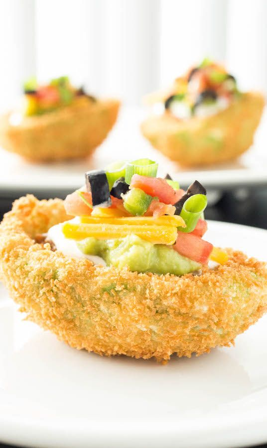The perfect game day appetizer - Spicy Seven Layer Dip Stuffed Fried Avocados #ad #vivalamorena