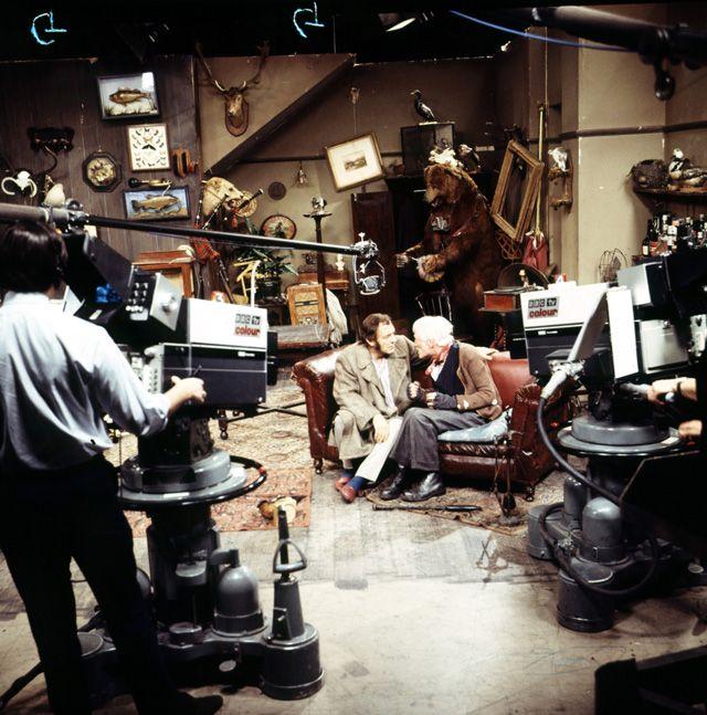 Harry H. Corbett and Wilfrid Brambell on set filming Steptoe and Son.