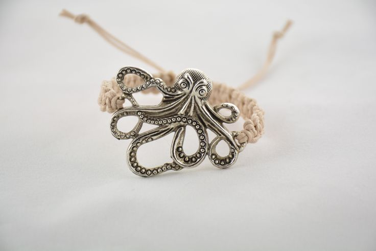 """Bungalow"" Bracelet, 6-strand, waxed cotton cord, double square knotted with large metal octopus focal element. Handmade, all-natural jewelry made with ancient macrame technique and inspired by the beaches of Sarasota.  See more colors and styles at www.theknottedstone.com"