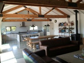Stunning Kitchen with concrete floor and decorative beams