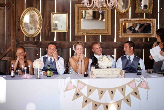 just married banner on wedding party table