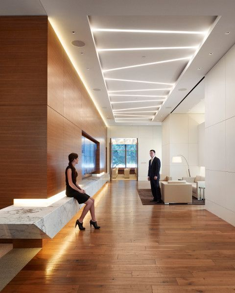 FIG. 1. The reception area in the Cole Capital office building combines geometrically placed Neo-Ray linear fluorescent fixtures for ambient...