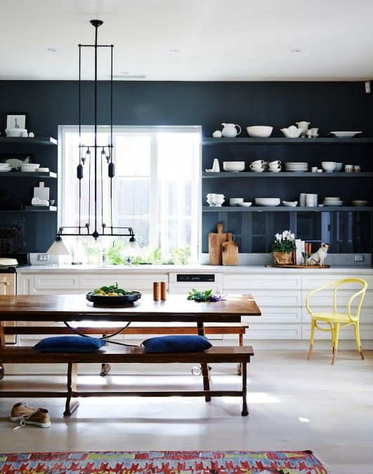 White crockery against the dark walls in this modern kitchen creates a really striking feature thanks to the open shelves