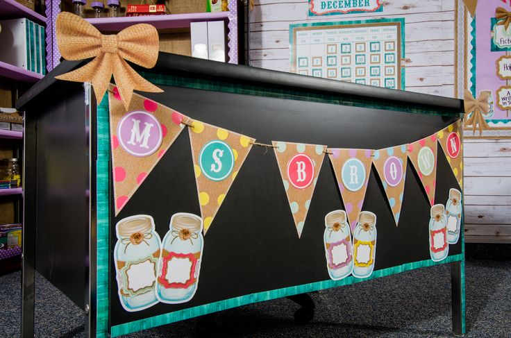 Dress up your desk! Shabby Chic classroom decorations will add style to your desk. We used Shabby Chic Pennants, Circle Letters, Burlap Bow, Mason Jar Accents and Shabby Chic Magnetic Strips in this classroom.
