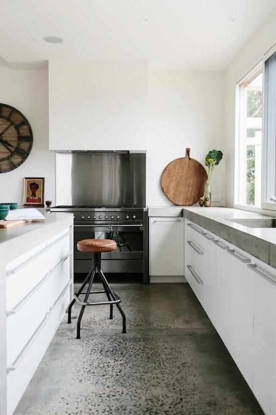 white kitchen. Amazing concrete floor