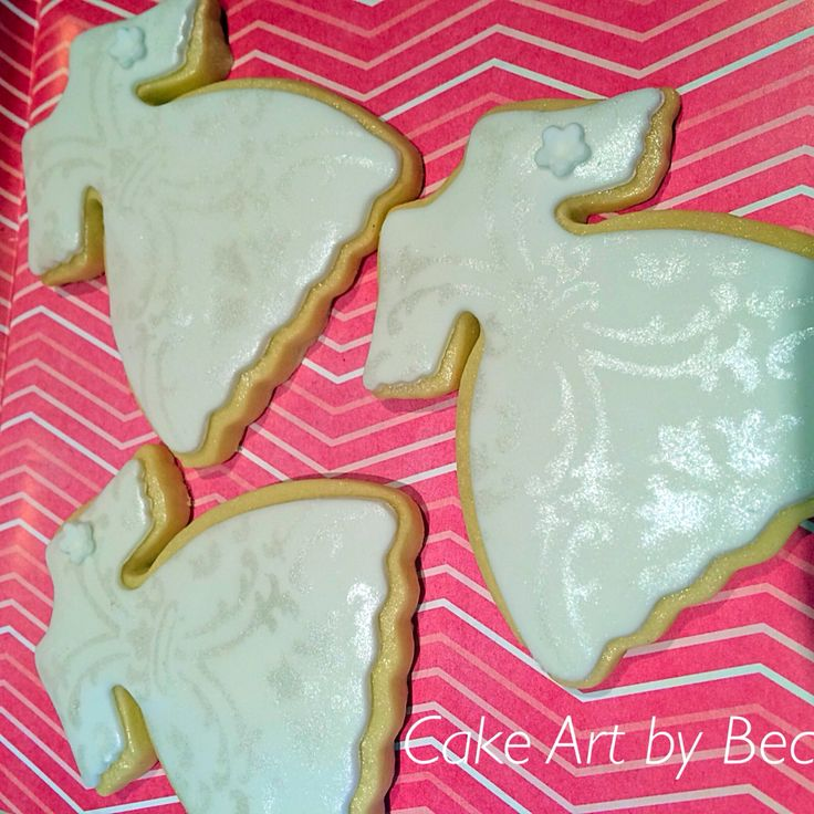Little biscuit dresses, they were used as a thank you at a baby shower. By cake art by Bec.