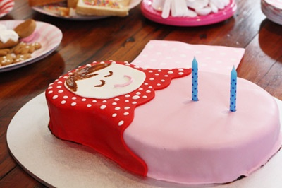 .. you could cut the nesting doll open and have the gender somehow exposed ..in icing, or a small pink or blue doll hidden in the cake.. or something clever..