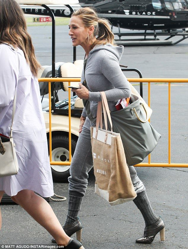 Why not:Throwing caution to the wind, Parker tucked her pants into high grey woolen socks that gave the distinction of stress-free living