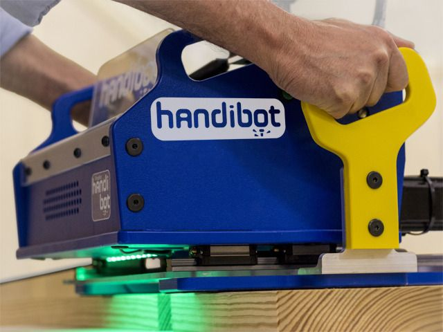 """Handibot / """"The Handibot is what they're calling a """"smart tool,"""" and it's essentially a 3-axis CNC mill that you can carry (and run via PC, tablet or even smartphone). But don't let the small size fool you: By """"tiling"""" your digital files and registering the Handibot from one location to the next, you can work on surfaces of unlimited size with total CNC precision"""""""