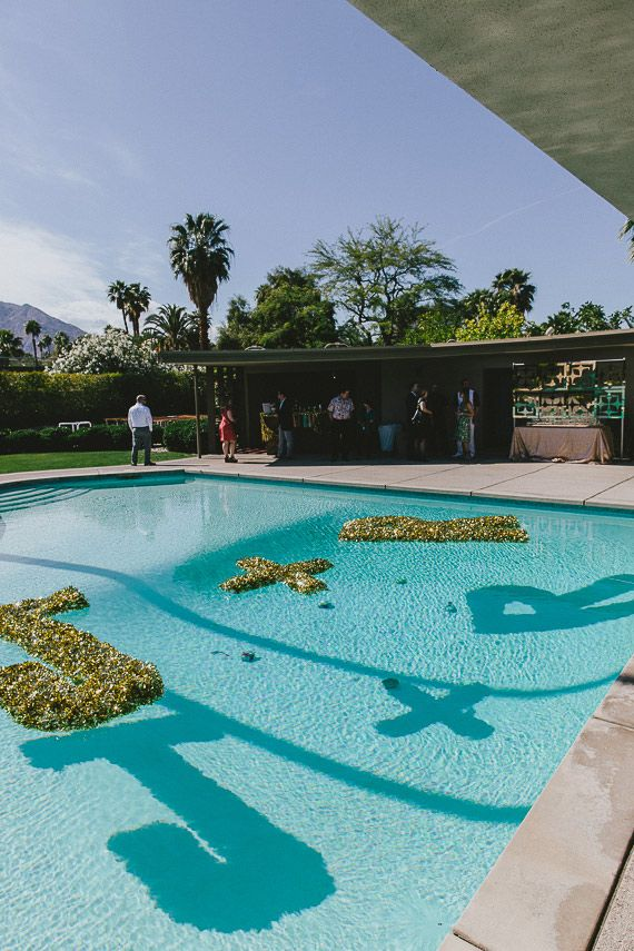 Gold initials in the pool | Design by Jesi Haack  | Photo by Steve Cowell | Read more  http://www.100layercake.com/blog/?p=74949Mid-centur...