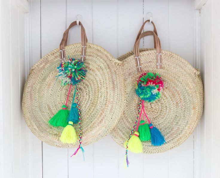 Hand made in Morocco. These make fabulous eco-friendly shopping or useful storage baskets. The straps are made from genuine leather and the pom-poms and tassels are each made by hand. Fill them with fresh flowers, wine, fruit and vegetables – no need
