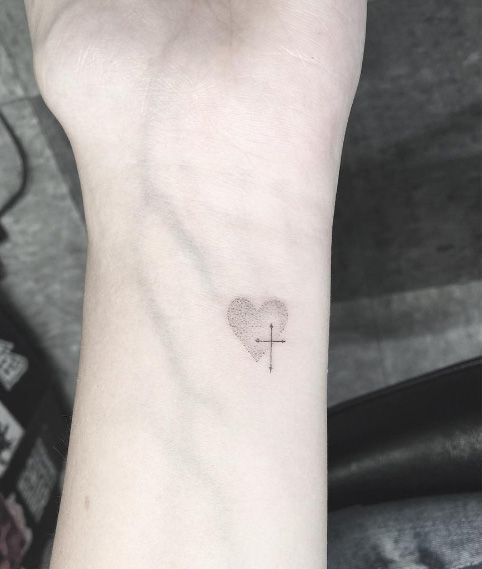 Tiny cross heart tattoo