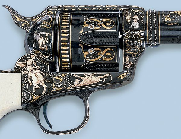Engraver Leonard Francolini.  These guns depict the lives of the Cowboys and the Indians of the American West. Paul Goodwin photo.