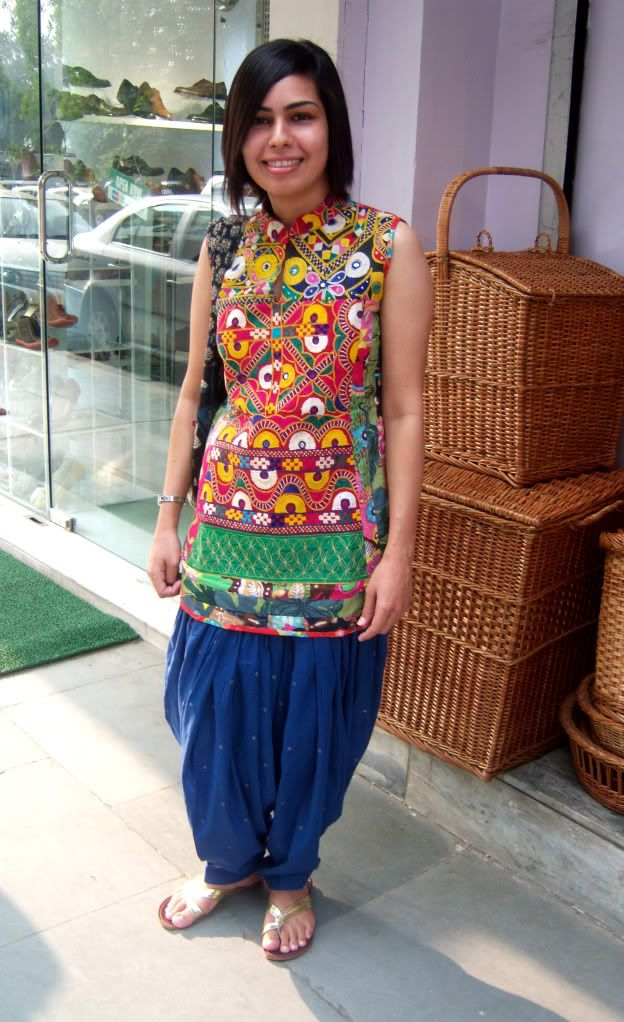 Kutchi kameez with blue sequined salwar and gold chappals. So awesome.