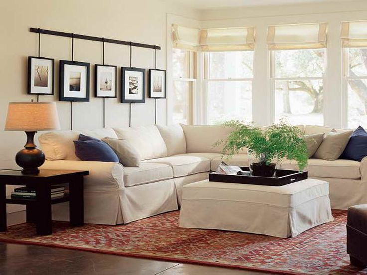 Sectional Couch Covers Table Lamps White Coffee Table Vase Glass Windows  Cushions Area Rug Wood Floors