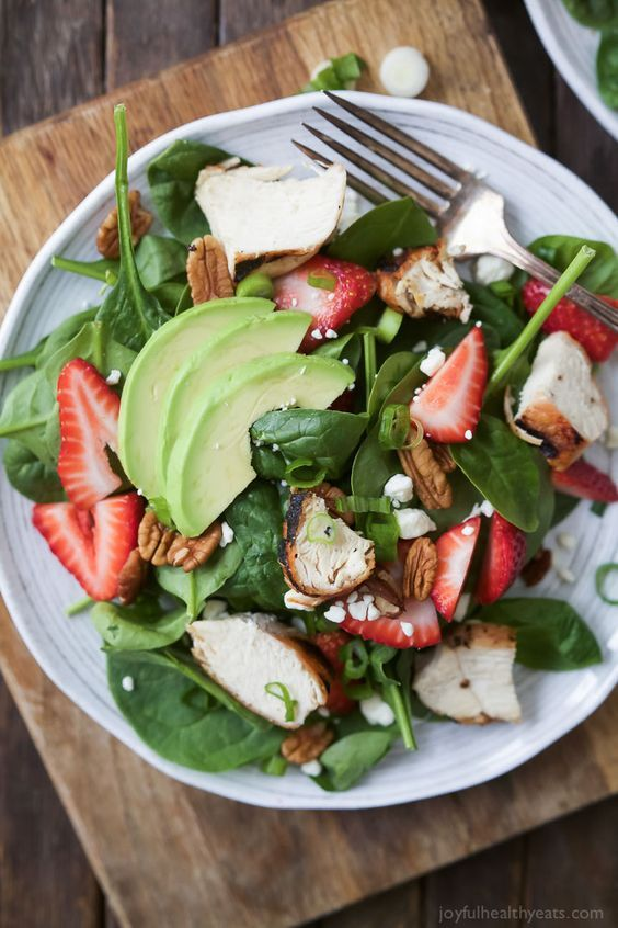 Strawberry Avocado Chicken Salad filled with fresh Berries, Feta, creamy Avocado, and Grilled Chicken. This light salad is topped with a healthy balsamic vinaigrette. The perfect healthy salad option for the summer, bring on the swimsuits!   joyfulhealthyeats.com #glutenfree