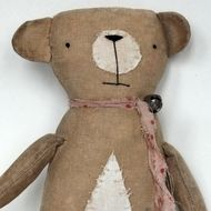 This little bear ,measuring 27cms. and about 21cms sitting is made from coffee and cinnamon dyed linen - sanded back for primitive loveliness. He has embroidered features and his tummy patch and muzzle are made from a vintage 1960's petticoat .He sport...