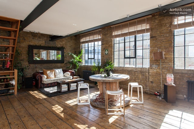 Gorgeous London loft - adore the exposed brick, wooden floorboards & masses of natural light flooding the space. Beautifully boho.