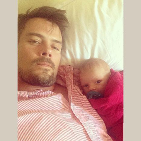 Josh Duhamel cuddles up to Baby Boy Axl to watch football.