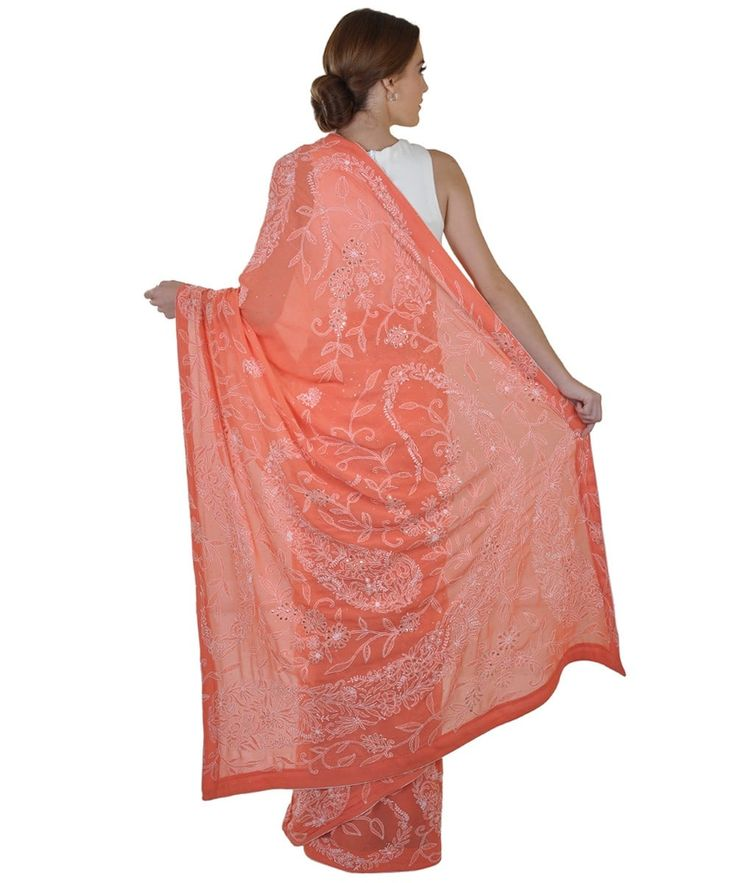 <p>This beautiful paisley chikankari pure georgette saree in peachy orange colour has ivory chikankari floral booteh all over and floral with long paisley jaal on pallav, skirt and matha patti border. The saree is embellished with hand embroidered a