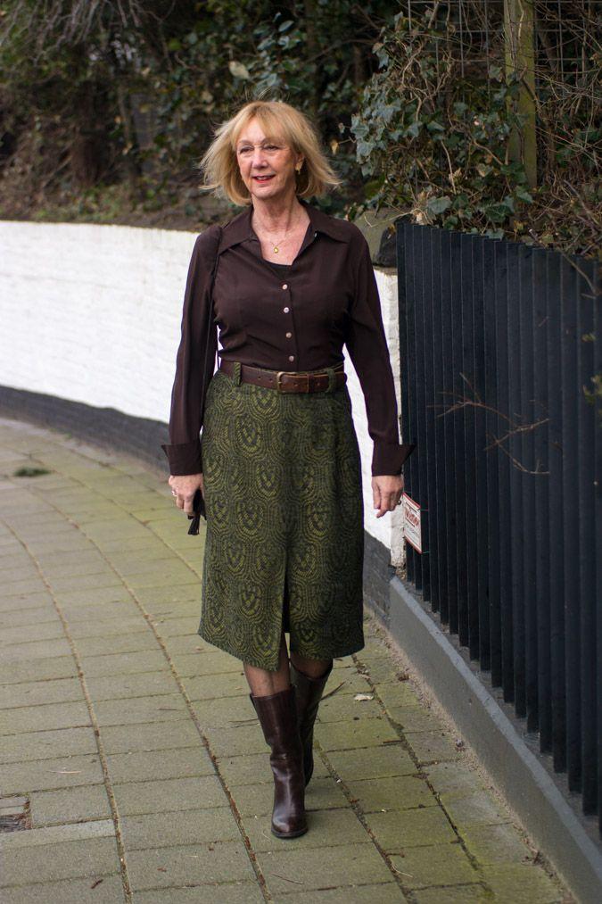 Green midi skirt by Essentiel Antwerp Brown boots by Max Mara.