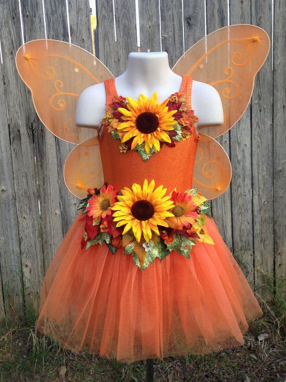 A sunny fall fairy costume for the autumn-loving little girl! The top is a stretchy, jewel-style-sparkle leotard, adorned with a big happy