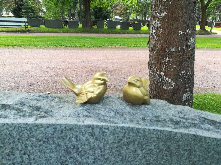 Golden birds, gravestone , graveyard Minttuphoto