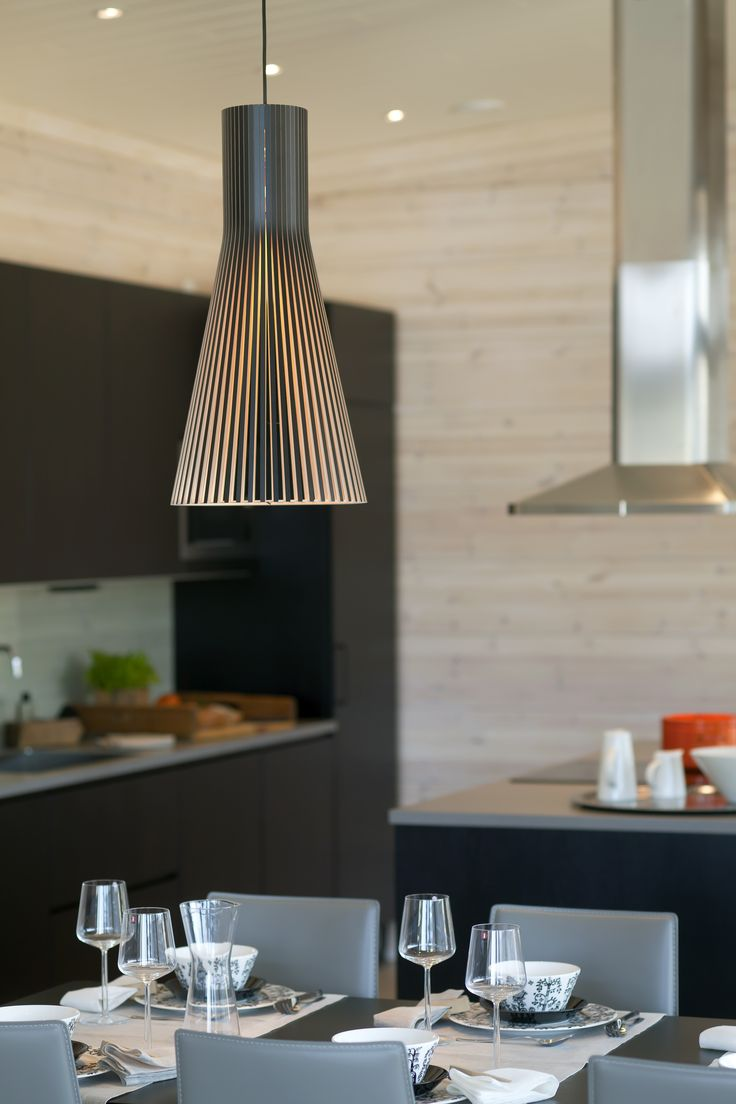 Secto lamps. Log walls treated with Paneeli-Ässä 1600, white, Tikkurila. Honka log homes.