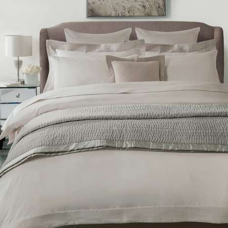 Crafted from 100% cotton with a luxurious 300 thread count, this super soft duvet cover in warm taupe from the exclusive Hotel range features stylish pintuck edging and is machine washable.