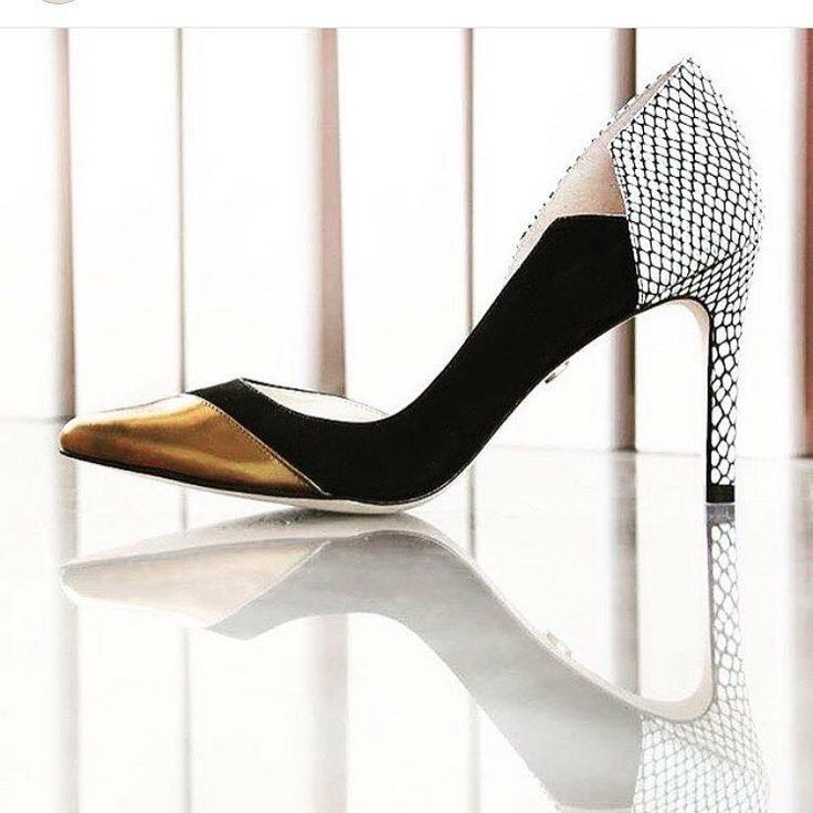 Show the world you mean business with these feminine pumps, featuring a metallic pointed toe and black suede frame, with a chic cutout along the inner side. SHOP ONLINE NOW AT www.classy-avenue.com #guilherminashoes #guilhermina #musthave #madeinbrazil #itshoe #iconheels #instagood #itshoe #ootd #onlineshopping #toronto_insta #torontoblogger #torontofashion #fashinblogger #fashionista #newyorkbloggers #newyorkfashion
