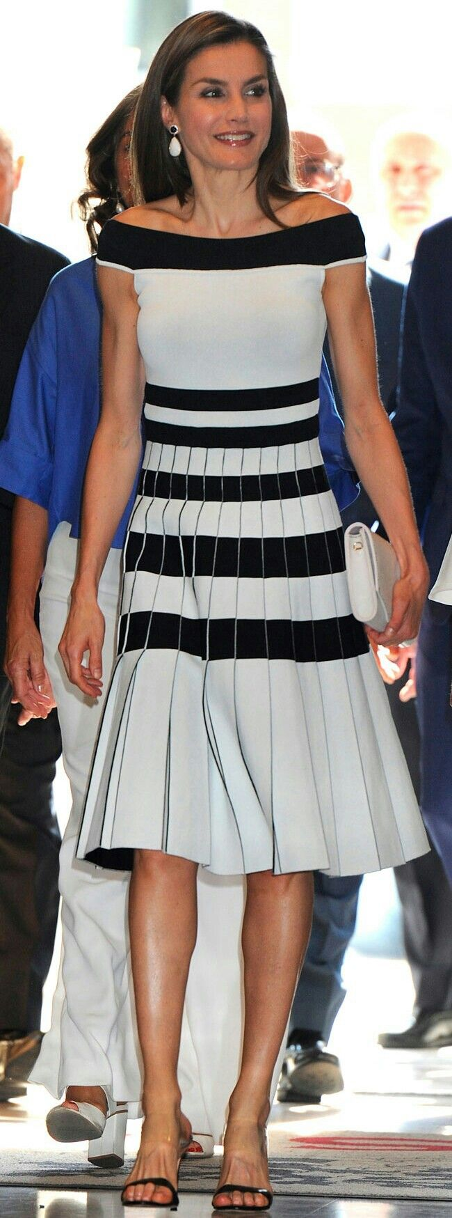 Queen Letizia - White and black striped off-the-shoulder black and white dress by Carolina Herrera - Carolina Herrera black heeled mules - white Felipe Prieto flap leather clutch bag - Coolook'luna' earrings