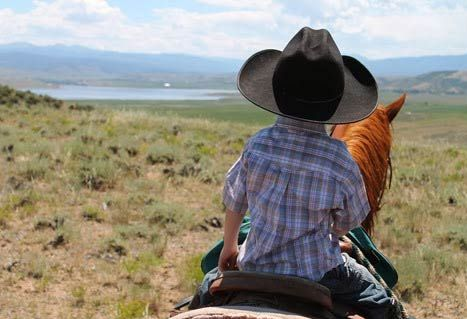 Dude Ranch family vacation destination near Colorado Rocky Mountain NP: nonstop fun for ages 3-12: petting farm, pool, horse rides, daily activities & more.