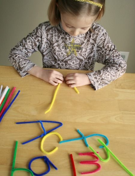 Making letters out of pipe cleaners