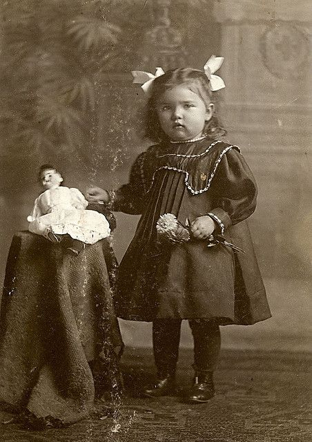 Girl and her doll via flickr