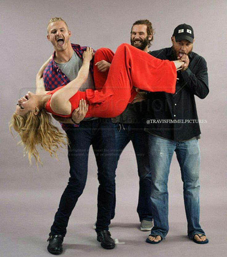 """VIkings cast """"Bjorn, Rollo, Ragnar"""" holding """"Lagertha."""""""