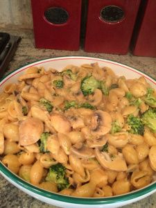 1 lb box of uncooked large shell pasta 2 cups cream 2-4 tablespoons butter 2 teaspoons minced garlic 1 8 oz can tomato sauce 1 head of broccoli, chopped 8 oz sliced fresh button mushrooms salt and pepper fresh grated parmesan cheese